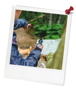 Students Orienteering Together Through the forest